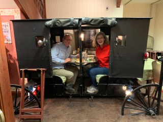 Dinning in an Amish buggy