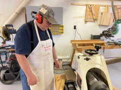 I had never used a drum sander. Frank instructed me. The drum sander was used to mill the cabinet support bracket to the correct thickness for the velcro tabs.